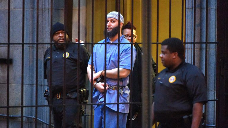 Officials escort convicted killer Adnan Syed, subject of the Serial podcast, from a courthouse in Baltimore in February 2016. (Karl Merton Ferron/Baltimore Sun/Tribune News Service via Getty Images)