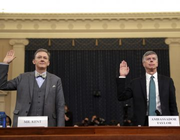 Career Foreign Service officer George Kent and top U.S. diplomat in Ukraine William Taylor, right, are sworn in to testify during the first public impeachment hearing of the House Intelligence Committee on Capitol Hill, Wednesday Nov. 13, 2019 in Washington.(AP Photo/Andrew Harnik)