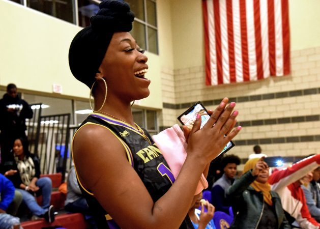 At a November 10 game against the Jersey Express, Camden Monarch dance coach Cherise Corn cheers for the team.  (April Saul for WHYY)