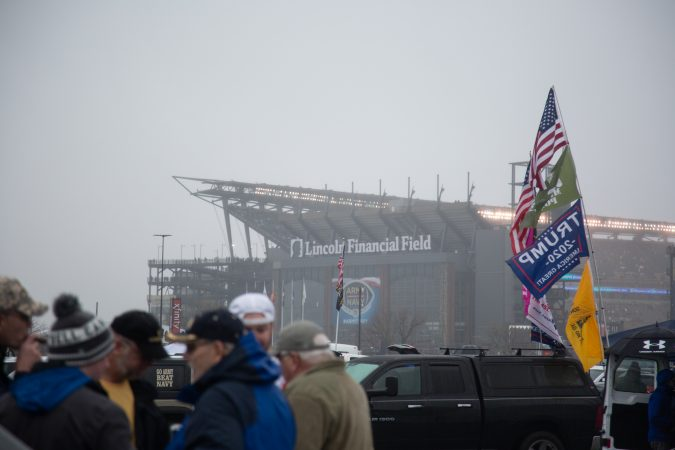 There was the occasional Trump 2020 banner amid team flags at the tailgates, and the president led the coin toss. But patriotism was the point, many said. (Emily Cohen for WHYY)