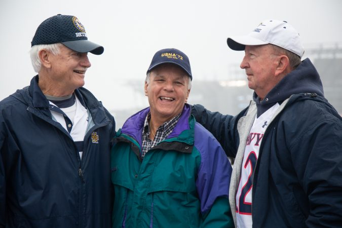 Don Carlson, Jerry Stahl, and Mike Brennan (left to right) graduated from the Naval academy in 1972. They've been coming to the annual Army-Navy game together since they were cadets. Today they traveled from Maryland, South Carolina, and Washington DC to watch the game together in Philadelphia, Pa on December 14th 2019. (Emily Cohen for WHYY)