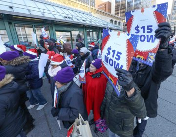 Cleaning workers protested for a higher minimum wage at Rodney Square Thursday, Dec. 19, 2019, in Wilmington, Del. (Saquan Stimpson for WHYY)