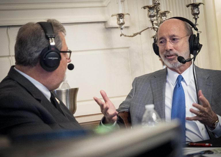 Pennsylvania Gov. Tom Wolf, right, speaks with Scott LaMar, host of WITF's Smart Talk, during a live broadcast at the Governor's Residence in Harrisburg on Dec. 11, 2019. (Joanne Cassaro/WITF)