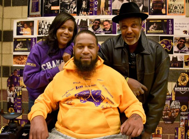 On December 8, Camden Monarchs owner Giovanni Thompson, her father, Ronnie Thompson and her brother, Monarchs' assistant coach Christian Thompson, pose after a game against the New York Elite Kings. (April Saul for WHYY)