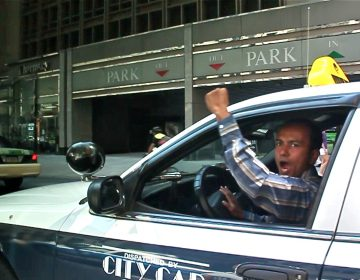 Taxi drivers honk their horns and chant 'PPA Mafia' as they drive slowly down Market Street toward City Hall during a protest against fee hikes in 2012. A video of the protest is part of the People's Media Record, an online archive set up by the Media Mobilizing Project. (Still from video)