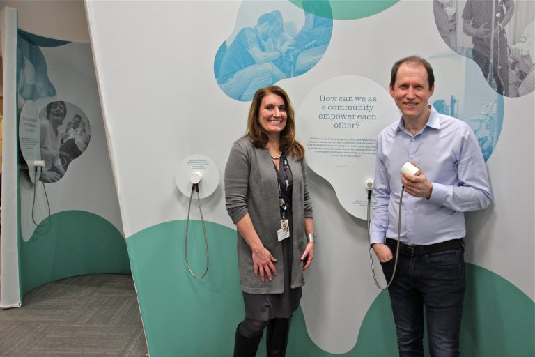 Stephanie Kindt (left) and Aaron Levy are the curators of Listening Lab, a year-long traveling exhibit that tells the stories of doctors and patients and explores the ways in which listening can improve care. (Emma Lee/WHYY)