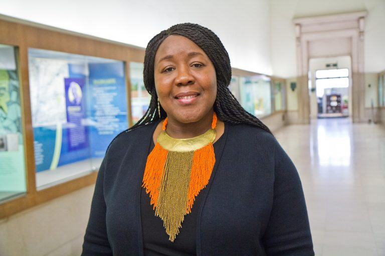 Trapeta B. Mayson is a poet, teacher and social worker based in Germantown. She was named Philadelphia's new poet laureate Thursday at the Free Library. (Kimberly Paynter/WHYY)