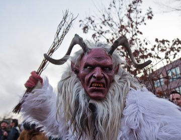 Graydon Dunkelberger studied abroad in Austria where he learned about Krampus. His was was hand carved in Austria. (Kimberly Paynter/WHYY)