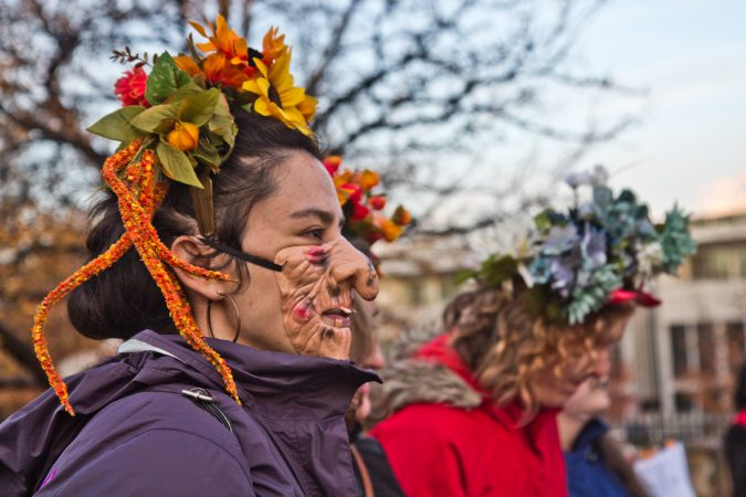 Shelia Dhand sings with the Philadelphia Women's Slavic Ensemble at the Parade of Spirits gathering at Liberty Lands Park. (Kimberly Paynter/WHYY)