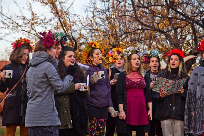 The Philadelphia Women's Slavic Ensemble sings during the Parade of Spirits gathering at Liberty Lands Park. (Kimberly Paynter/WHYY)