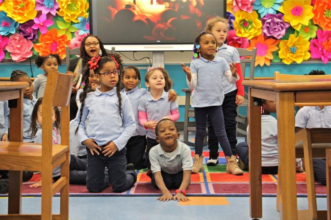 Kindergarten students at Bethune Elementary school react to the arrival of Philadelphia 76ers star Tobias Harris. (Emma Lee/WHYY)