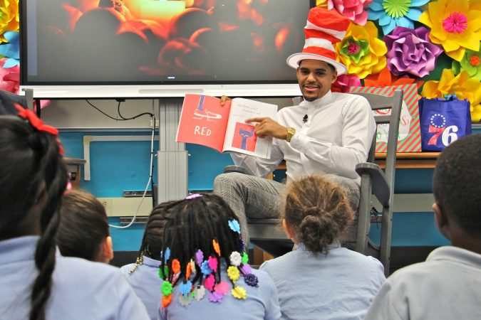 Sixers star Tobias Harris reads 'Pete the Cat' to a group of kindergarten students at Bethune Elementary School. (Emma Lee/WHYY)