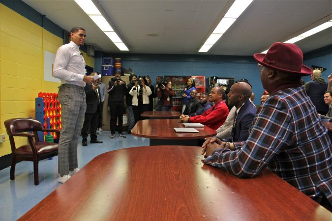 Basketball starr Tobias Harris speaks with a group of Black male teachers at Bethune Elementary School. (Emma Lee/WHYY)