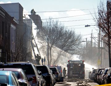 Firefighters respond to a fire in the 1400 block of South 8th Street. (Emma Lee/WHYY)