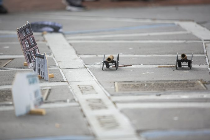 The miniatures include buildings and cannons. (Miguel Martinez for WHYY)