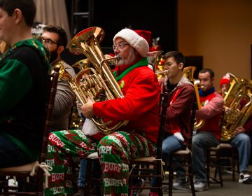 An ensemble of 100 tuba, sousaphone and euphonium players from the region, perform a TubaChristmas concert. (Kriston Jae Bethel for WHYY)