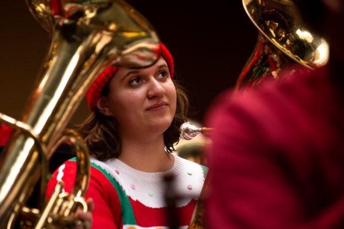 Jenn Michel of Washington Crossing listens during a performance of a Tuba Christmas. (Kriston Jae Bethel for WHYY)