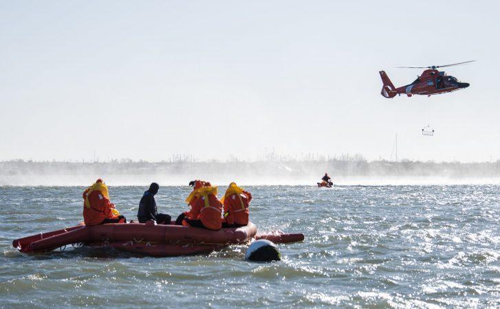 SERE trainees await rescue by the U.S. Coast Guard. (U.S. Air Force photo by Senior Airman Ariel Owings)