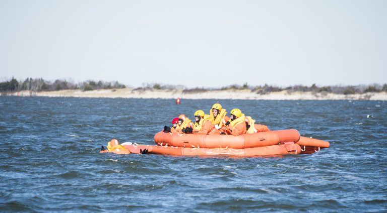 SERE trainees in a life raft. (U.S. Air Force photo by Senior Airman Ariel Owings)