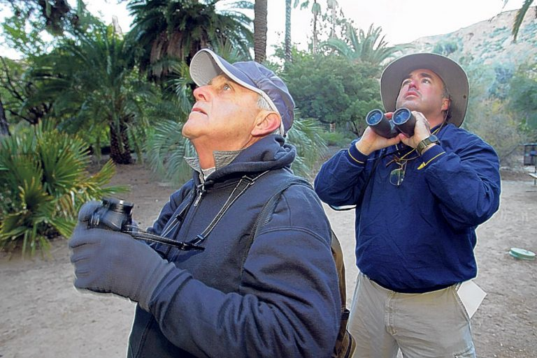 Dale Thayer of British Columbia, Canada, left, and Craig Peyton, of Phoenix, look for birds at the Boyce Thompson Arboretum in Superior, Ariz. in this Jan. 4, 2007. (AP Photo/East Valley Tribune, Toru Kawana)