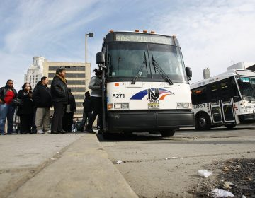 Passengers board an NJ Transit bus in Camden, N.J. (Mel Evans/AP Photo)