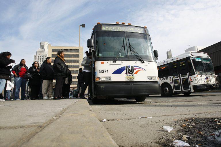 Passengers board an NJ Transit bus in Camden, N.J. (Mel Evans/AP Photo)