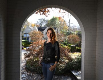 Georgia Tech professor Kim Cobb is shown at her home on Wednesday, Nov. 27, 2019 in Atlanta. Cobb is one of a number of scientists  deciding to do their part in cutting back on global warming by decreasing flying, composting leaves and waste, as well as using solar panels among other things. (John Amis/AP Photo)