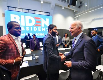 In this Nov. 21, 2019, file photo, Democratic presidential candidate former Vice President Joe Biden, right, walks around a table meeting with an assembly of Southern black mayors including Mississippi Mayor Chokwe Lumumba and Virginia Mayor Levar Stoney, left, in Atlanta. Biden is leading the most diverse presidential field in history among black voters. (AP Photo/John Amis, File)