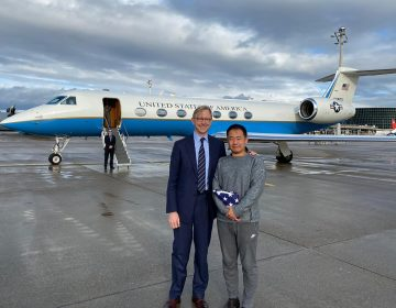 This photo provided by the U.S. State Department, U.S. special representative for Iran, Brian Hook stands with Xiyue Wang in Zurich, Switzerland on Saturday, Dec. 7, 2019.  In a trade conducted in Zurich, Iranian officials handed over Chinese-American graduate student Xiyue Wang, detained in Tehran since 2016, for scientist Massoud Soleimani, who had faced a federal trial in Georgia. (U.S. State Department via AP)
