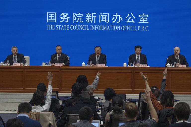 Shohrat Zakir, chairman of China's Xinjiang Uighur Autonomous Region, (center), waits for questions during a press conference in Beijing on Monday, Dec. 9, 2019. (Ng Han Guan/AP Photo)
