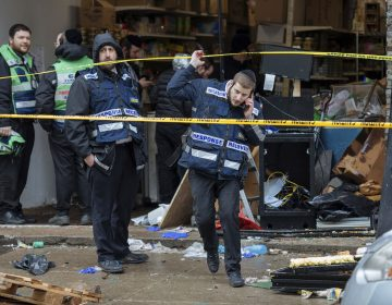Responders work to clean up the scene of a shooting that left multiple dead at a kosher market on Dec. 11, 2018, in Jersey City, NJ. Police killed two gunmen who had earlier killed an officer at a cemetery in Jersey City. (Kevin Hagen/AP Photo)