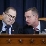 House Judiciary Committee Chairman Jerry Nadler, D-N.Y., left, with Rep. Doug Collins, R-Ga., right, the ranking member, listening to opening statements during a markup of the articles of impeachment against President Donald Trump, on Capitol Hill in Washington, Wednesday, Dec. 11, 2019. (Shawn Thew/Pool via AP)