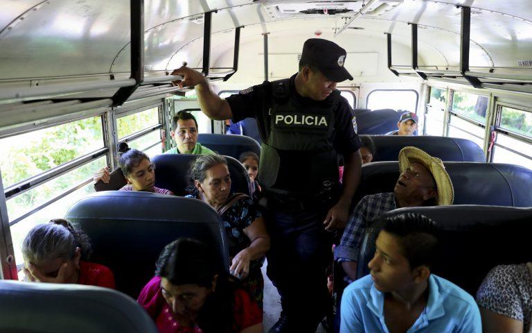 A policeman checks IDs as part of a routine patrol at the border crossing with Guatemala, La Hachadura, El Salvador. (Eduardo Verdugo/AP Photo)