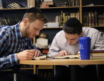 Yeshiva University students Aaron Heideman, (left), and Marc Shapiro study in the university's library in New York, Thursday, Dec. 12, 2019. They praised President Donald Trump's executive order to expand the scope of potential anti-Semitism complaints on U.S. college campuses. They said they worry that friends attending other universities might be targeted by anti-Semitic attacks and that this could help protect them. (Luis Andres Henao/AP Photo)