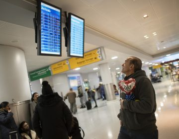 "In this Dec. 3, 2019, photo, Mohammed Hafar checks the arrivals road while waiting for his daughter Jana Hafar's flight at JFK Airport in New York. Mohammed Hafar was part of a federal lawsuit filed in August of this year over the travel ban waiver process. ""Every time I speak to her, she ask, 'When are they going to give me the visa?'"