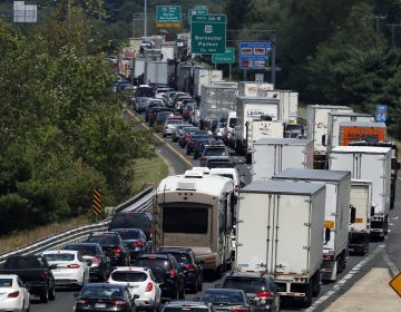 FILE - In this Aug. 12, 2016, file photo, traffic crawls eastbound on Interstate 84 in Sturbridge, Mass., after an overnight accident involving two tractor-trailers on the Massachusetts Turnpike. An alliance of Northeast and mid-Atlantic states are working on a pact aimed at lowering carbon emissions from cars, trucks and other means of transportation. A draft version of the agreement, known as the Transportation and Climate Initiative, was released Tuesday, Dec. 17, 2019. (Bill Sikes/AP Photo)