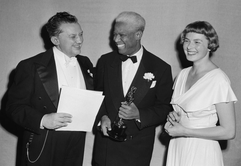 Jean Hersholt, from left, president of Academy of Motion Pictures Arts and Sciences, congratulates James Baskett, second African American to win an Oscar, for his special award for his portrayal of Uncle Remus in the 1946 Disney feature film