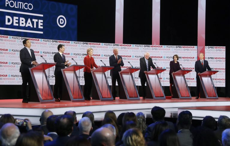 Democratic presidential candidates from left, entrepreneur Andrew Yang, South Bend Mayor Pete Buttigieg, Sen. Elizabeth Warren, D-Mass., former Vice President Joe Biden, Sen. Bernie Sanders, I-Vt., Sen. Amy Klobuchar, D-Minn., and businessman Tom Steyer participate in a Democratic presidential primary debate Thursday, Dec. 19, 2019, in Los Angeles. (Chris Carlson/AP Photo)