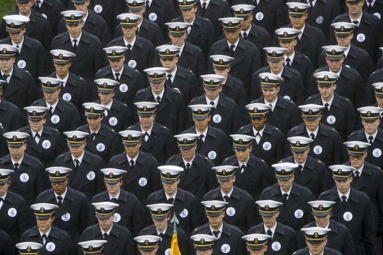 Navy midshipmen march onto field ahead of an NCAA college football game between the Army and the Navy in Philadelphia. (Matt Rourke/AP Photo)