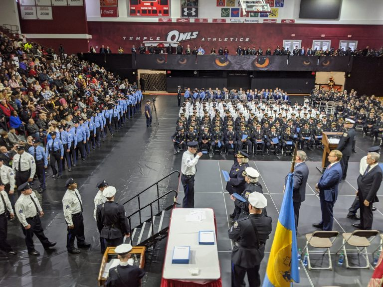 The Philadelphia Police Department tweeted this photo on Wednesday of a ceremony at Temple University where nearly 200 officers were promoted, three of whom have been accused of misconduct. (Courtesy of Philadelphia Police)