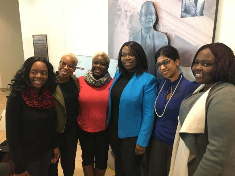 Former refugees joined advocates at the signing ceremony. From left, Sophie Marie Namugenyi, director of support services at Jewish Family Services; Saybah Wolokolie; Ajawavi J. Ajavon; Lourena Gboeah, refugee from Liberia; Padmaja Charya, refugee therapist with JFS; and Jenevive Newman, JFS refugee case manager. (Mark Eichmann/WHYY)