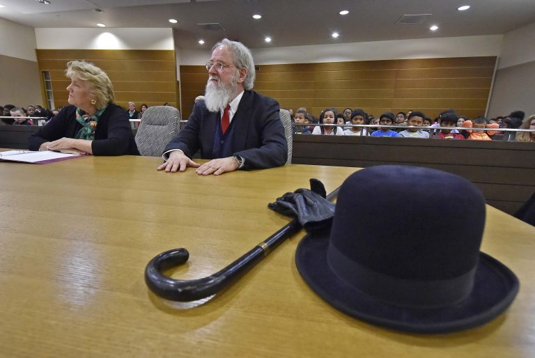 The Honorable M. Jane Brady sits next to Kent County, De. Family Court Judge James G. McGiffin, Jr., portraying Kris Kringle take part in a Christmas performance inside a courtroom at the New Castle County Courthouse in downtown Wilmington on Friday, Dec. 13, 2019.    (Butch Comegys for WHYY)