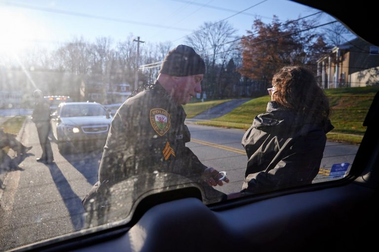 Malinda Clatterbuck is arrested by Uwchlan Township police. (David Parry of outsidetheimage.com)