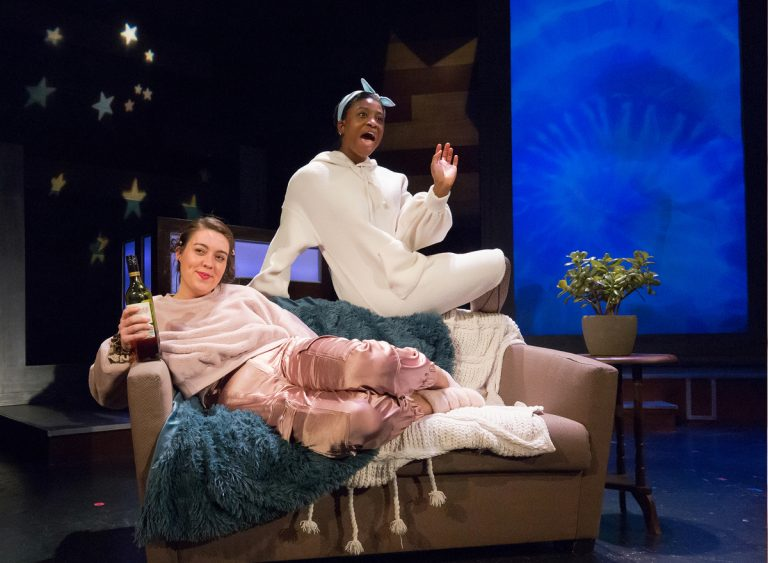 Tanaquil Márquez (left) and Brett Ashley Robinson in a skit about self-care at 'This Is the Week That Is.' (Courtesy of Mark Garvin)