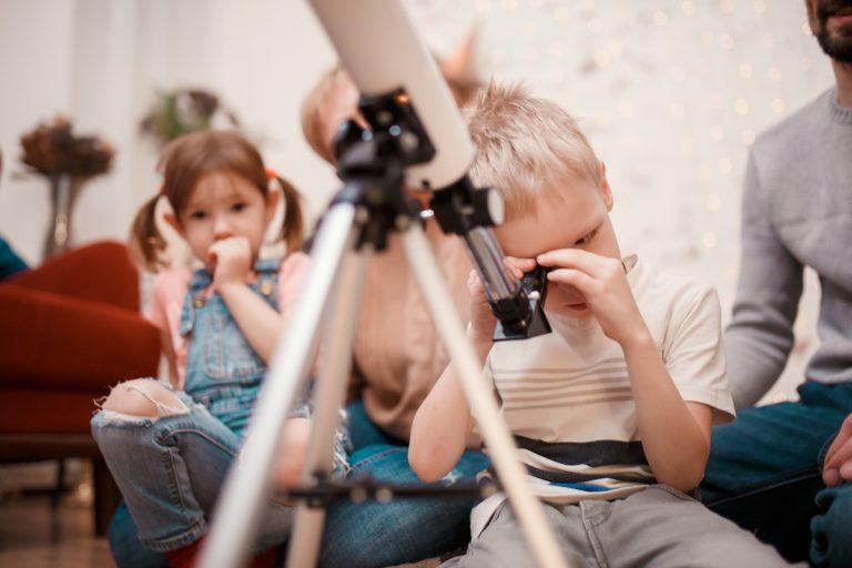 child with telescope