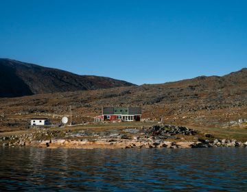 The Nielsens' sheep farm sits on the edge of a fjord in southern Greenland. The family has owned and run the farm since 1972. (Claire Harbage/NPR)