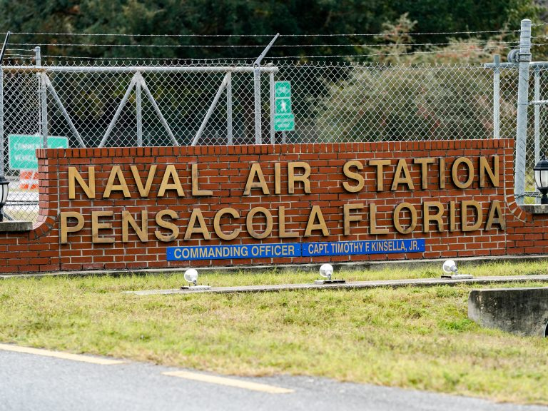 A gunman killed three people and injured eight others at Pensacola Naval Air Station on Friday. It was the second shooting on a U.S. Naval Base in a week. (Josh Brasted/Getty Images)
