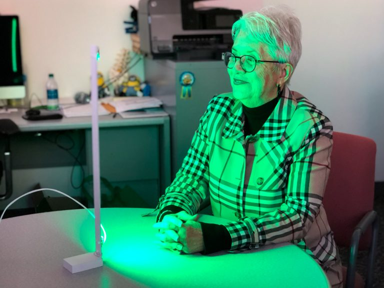 Ann Jones has been spending two hours each day in front of a green LED light— an experimental treatment aimed at alleviating migraines and other forms of chronic pain. (Will Stone for NPR)