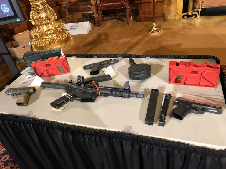 Guns, including ones made through DIY kits, are displayed on a table in the Governor's Reception Room of the state Capitol on Dec. 16, 2019. (Ed Mahon/PA Post)