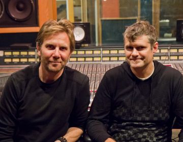 MilkBoy co-owners, Jamie Lokoff (left) and Tommy Joyner (right), started their music empire in Ardmore 25 years ago. (Kimberly Paynter/WHYY)